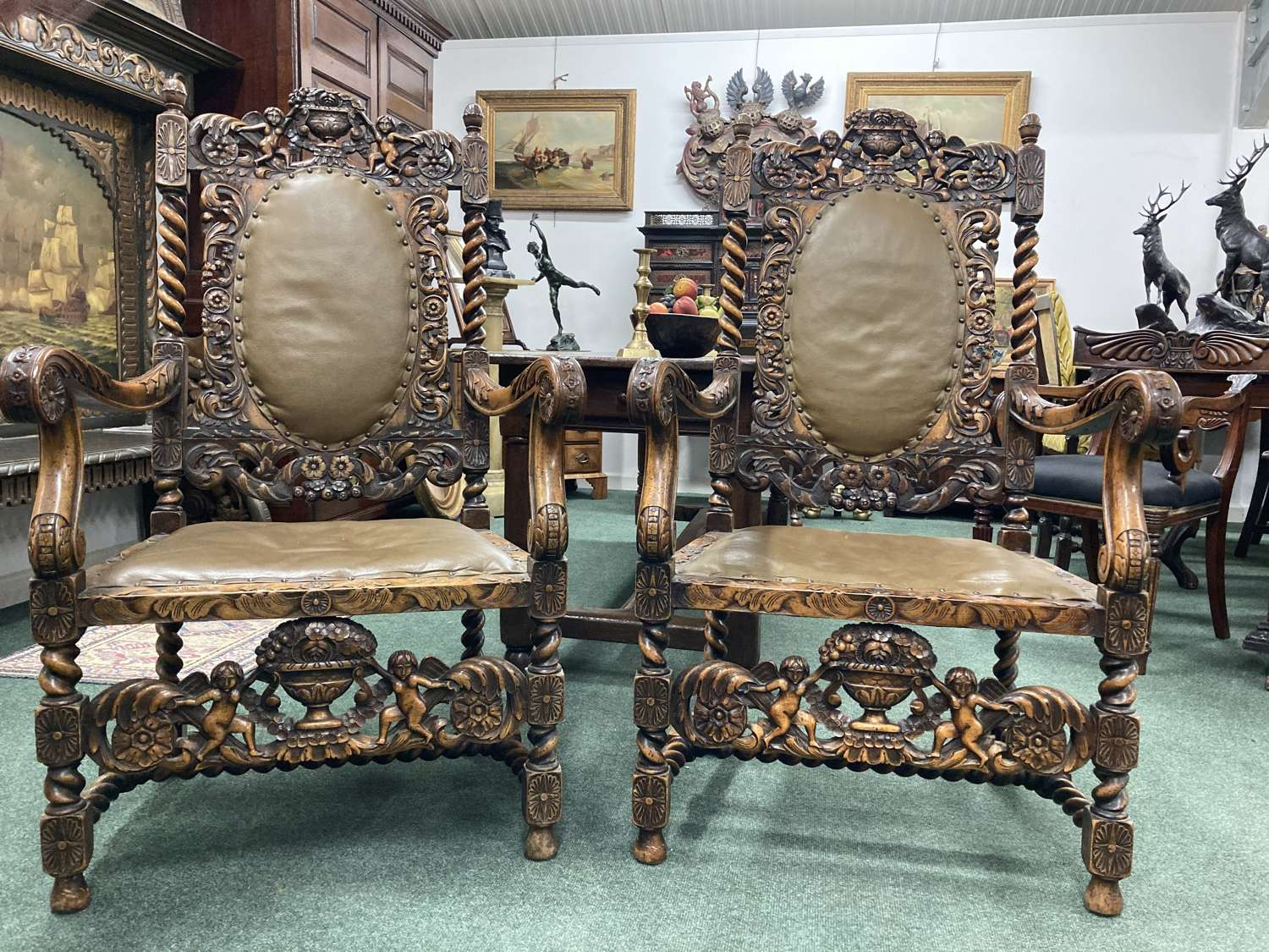 A pair of 19th Century carved Walnut armchairs